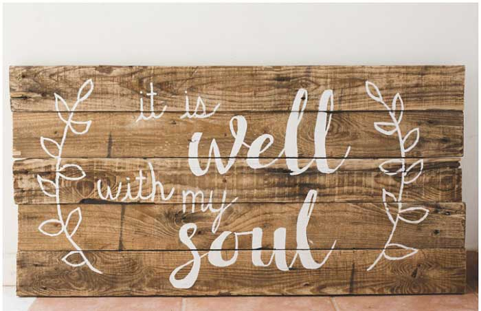 weathered wood pallet sign