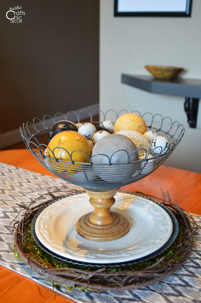 vintage eclectic centerpiece with croquet and other balls