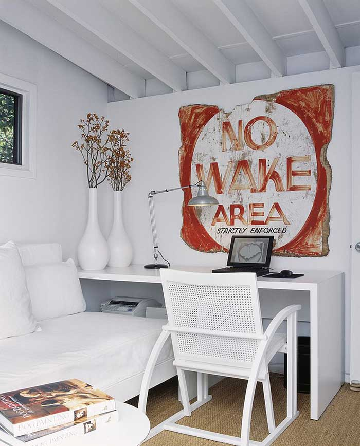 white office with distressed wood sign