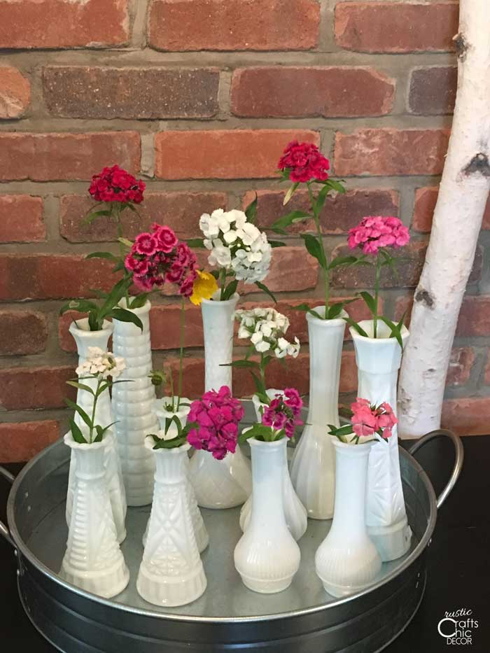 milk glass vases with wildflowers