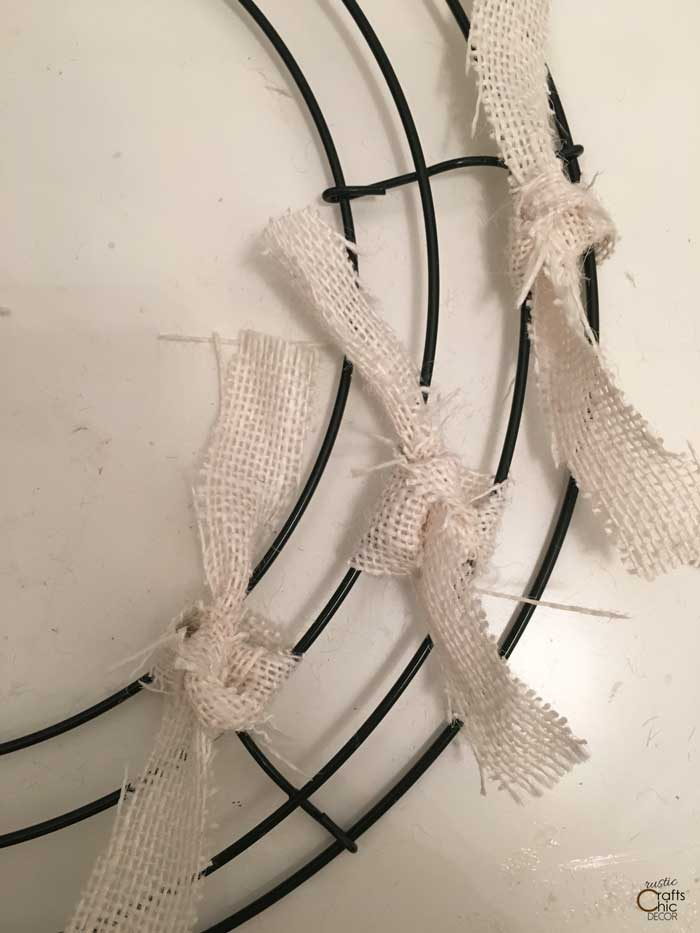 burlap strips tied to wire wreath form
