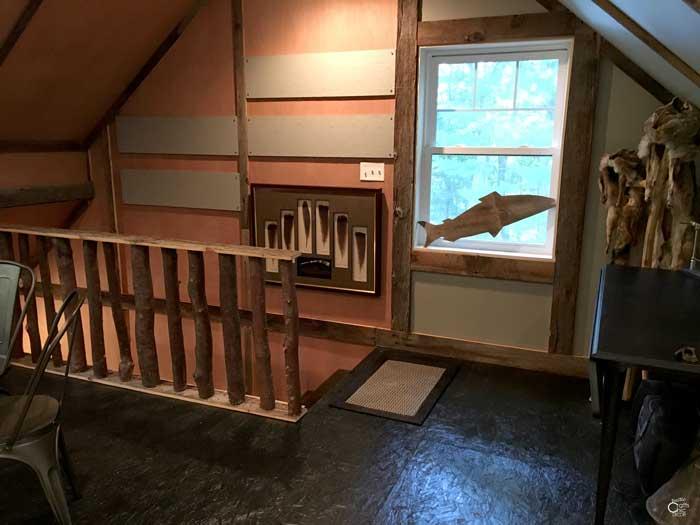 rustic 2 story garage stairway