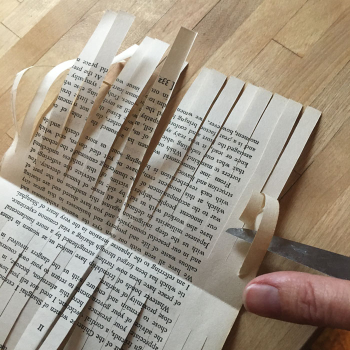 curled book page strips