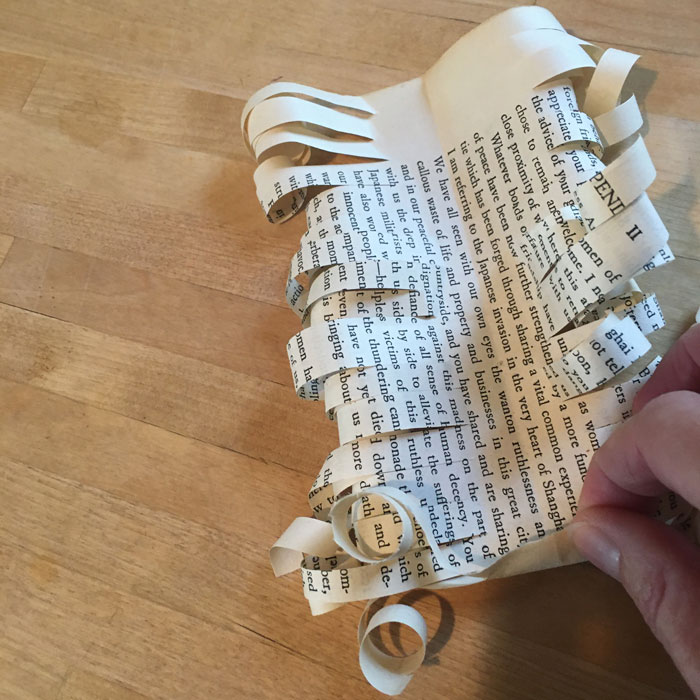 rolled book page bow