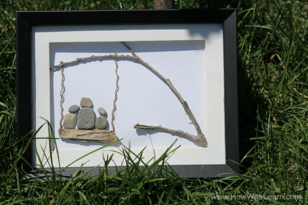 three on a swing pebble art