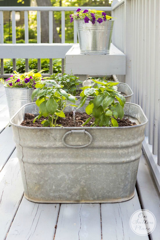 deck decorating with galvanized planters