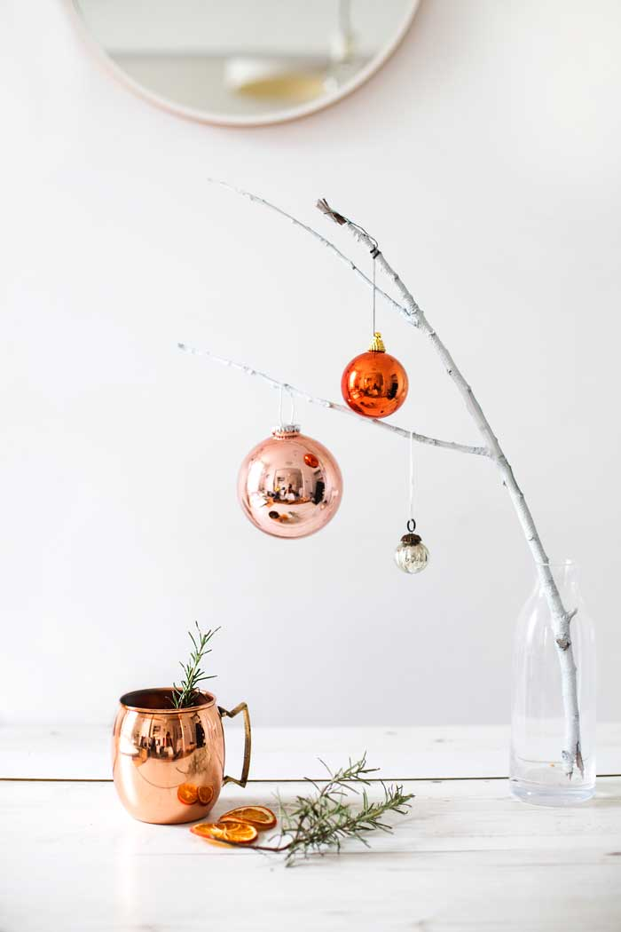 Christmas ornaments on branches