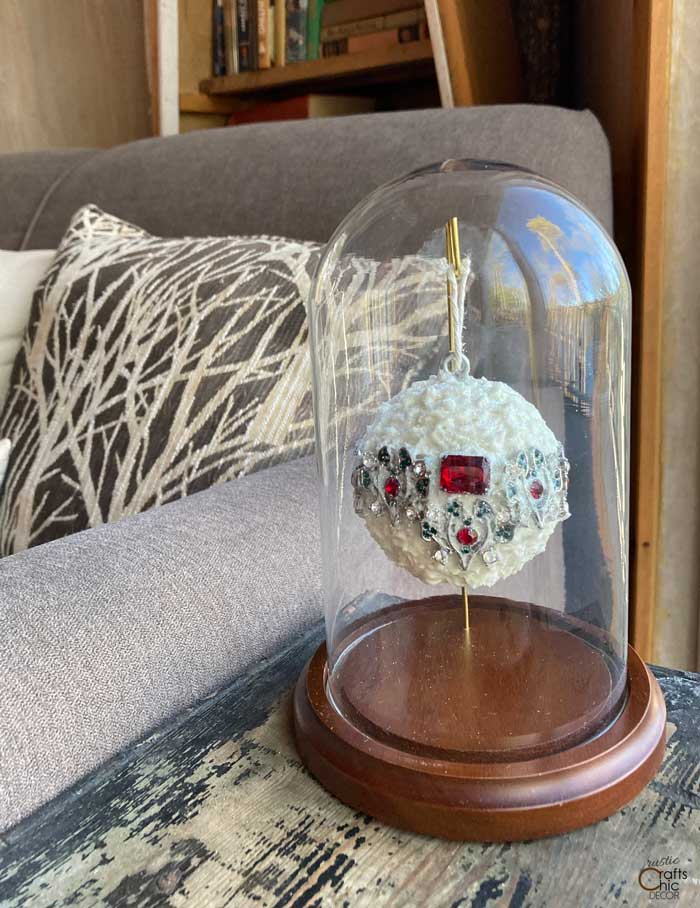 ornament hanging in glass dome