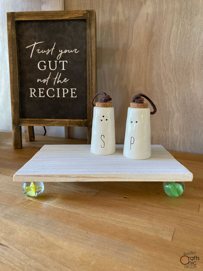 footed stand made with wood shims