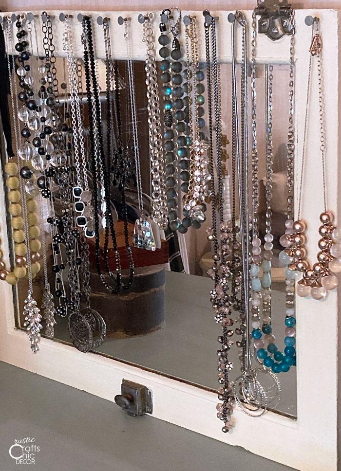 medicine cabinet necklace holder