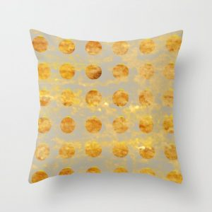 silver and gold ornament pillow
